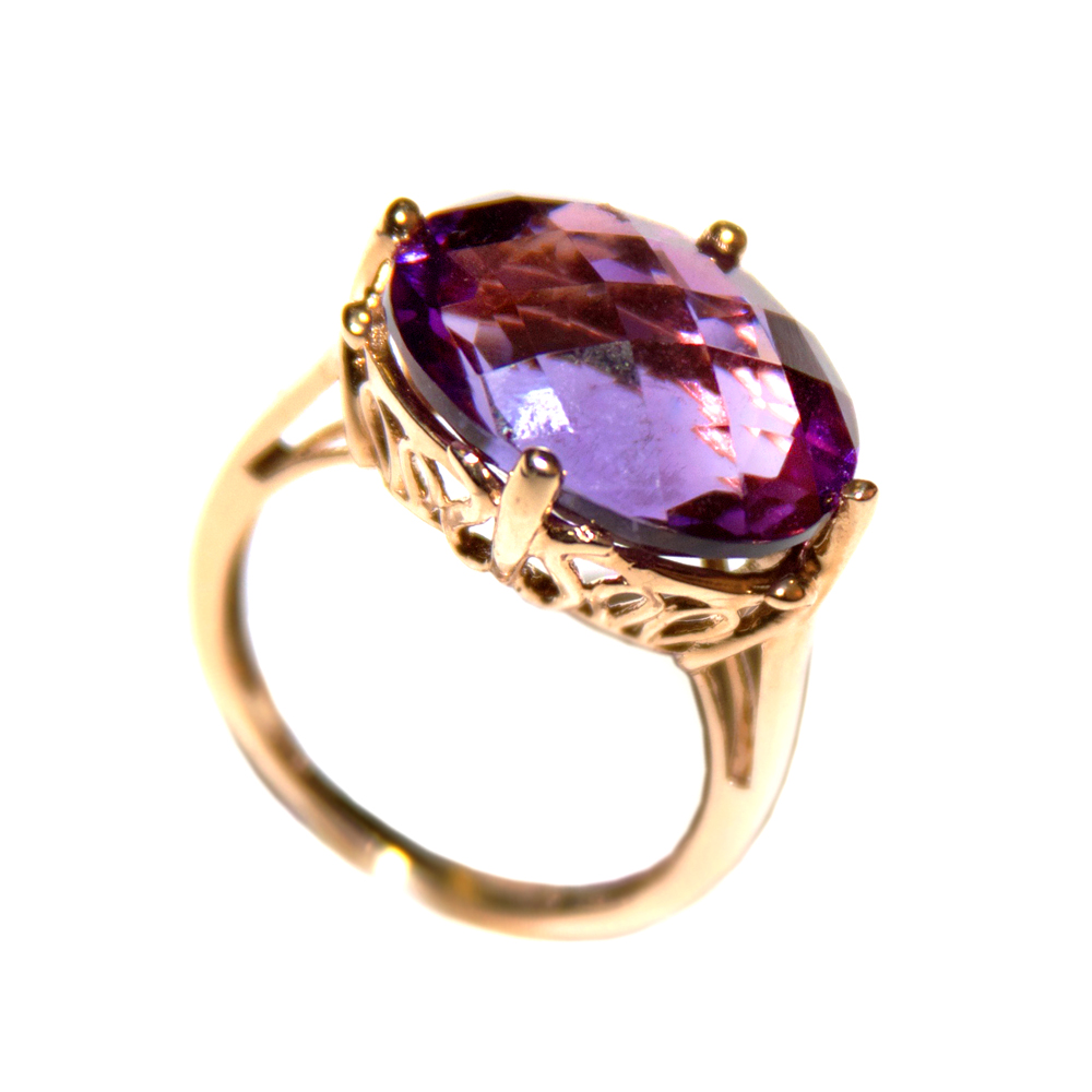 7.12 ct. Amethyst stone in a checkerboard oval cut in a 14ct. yellow gold setting. Size 7. $589.00