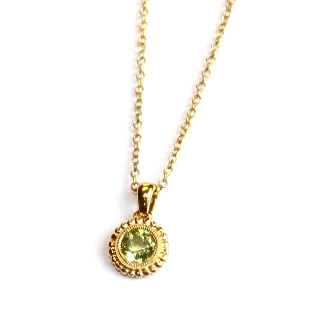 "Round checkerboard Peridot gemstone pendant on a 14ct. yellow gold, 18"" chain. $335.00"