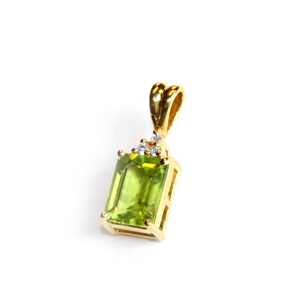 Rectangular checkerboard cut Peridot pendant in a 14ct. yellow gold setting. $235.00