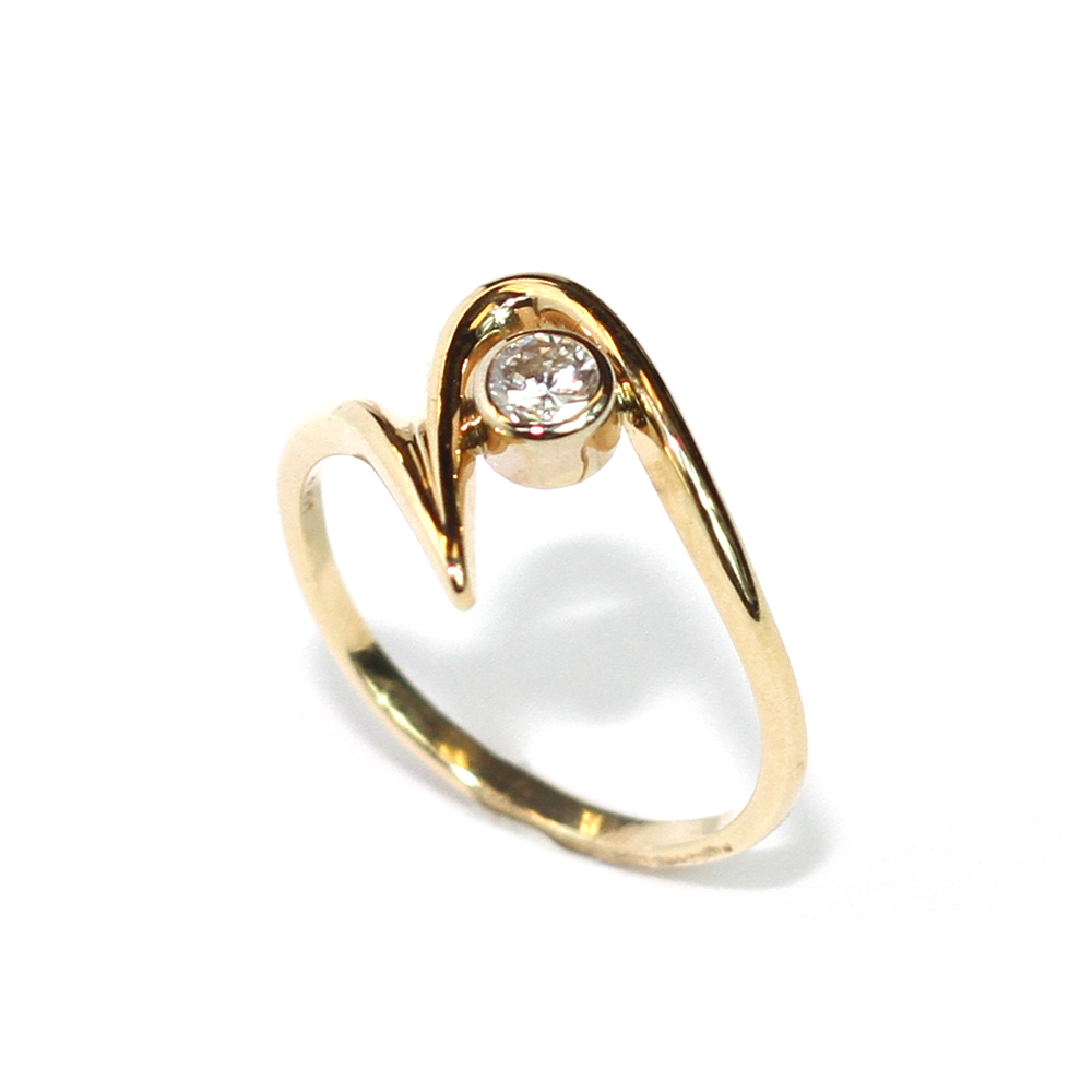 Unique 14 kt. yellow gold setting holds a .26 ct. diamond. $449.00