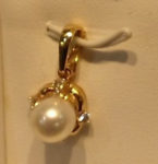 XXXPearl pendant with four diamonds (.09ct.), 14kt. yellow gold setting. $360
