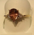 XXXPearl Tourmaline (10ct.) and Diamond (.01ct.) gemstone ring in 14kt. yellow gold setting. $365